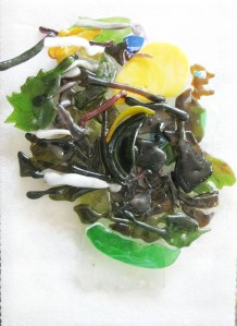 The colored pieces of Fused Glass are Stained Glass. This Homage to Giuseppe Arcimboldi is a profile facing right. Have you determined the features.